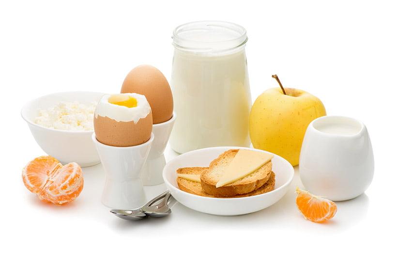 Boiled eggs toast milk apple and orange