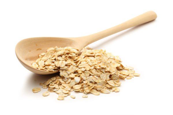 Wooden spoon full of oats