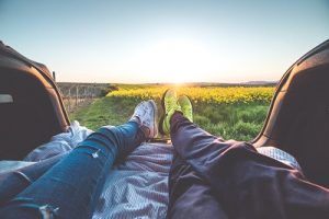 resizeyoung-couple-enjoying-romantic-sunset-from-car-trunk-picjumbo-com