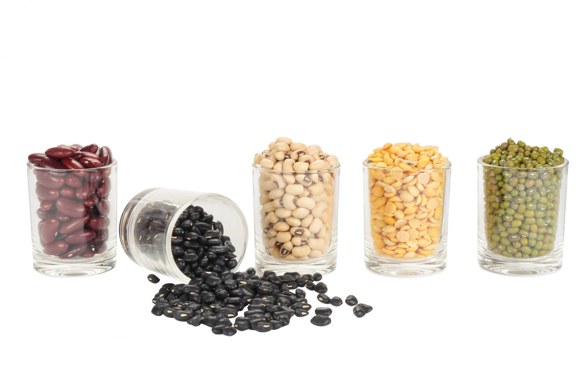 Glasses of dried legumes and beans